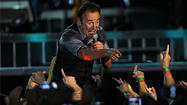Bruce Springsteen packs his concerts to bursting, and still it wasn't enough Friday in the first of two sold-out shows at Wrigley Field. There were 28 songs, 18 musicians and singers in the newly expanded E Street Band, and guest shots from Pearl Jam's Eddie Vedder and Rage Against the Machine's Tom Morello.