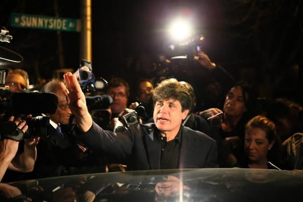 Former Gov. Rod Blagojevich waves to the crowd in front of his Chicago home as he leaves for prison March 15, 2012.