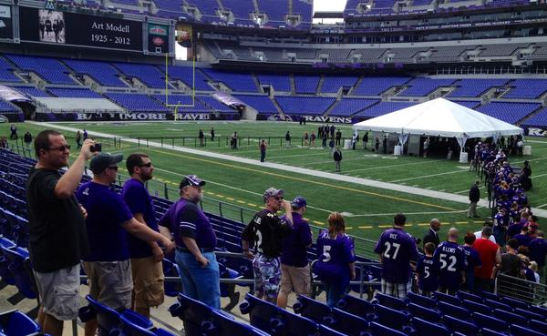 Fans wait in line to view the casket of Art Modell at M&T Bank Stadium.