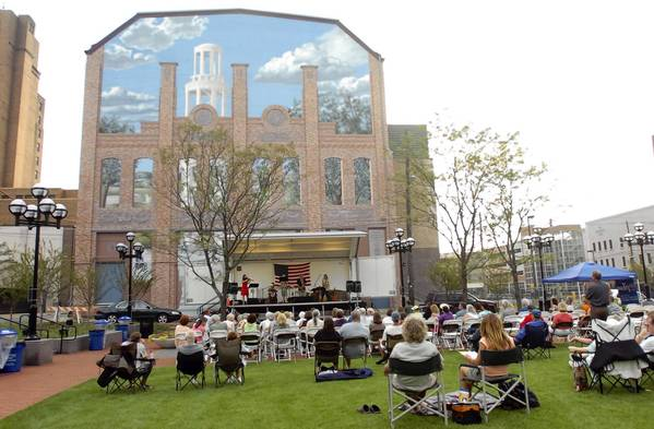"The Allentown Arts Park is the site of frequent events, such as this concert by ""Zen for Primates."" A massive mural on the back of Allentown Symphony Hall provides a dramatic backdrop to the stage."