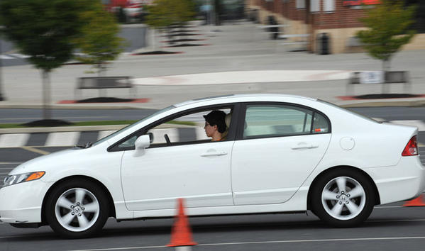 "Michael Lin, 16, of West Chester slams on his brakes at 45 mph Saturday. The Sports Car Club of America (SCCA) in conjunction with the Delaware Valley BMW CCA put on a Rack Street Survival event at Coca-Cola Park to give young drivers ""hands-on"" driving experience in real-world situations."