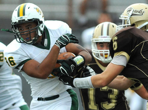 Emmaus's Daniel Velasco holds the ball tightly as Bethlehem Catholic players try to strip it away during Saturday's game at Bethlehem.