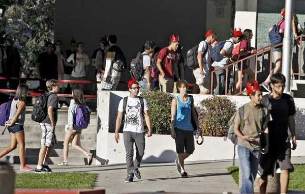 Students rush off to class during the first day of the new school year at La Canada High School in La Canada Flintridge.