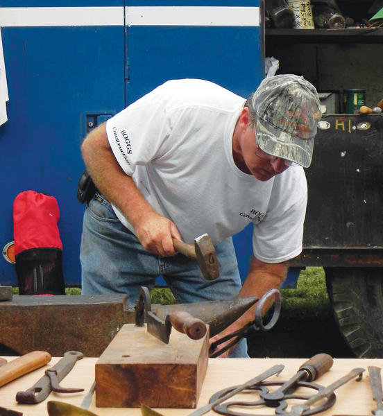 Jack Boggs demonstrates the art of blacksmithing Saturday at the Pennsylvania German Festival at Renfrew Museum and Park in Waynesboro, Pa.