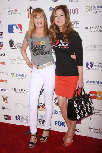 "Actresses Marg Helgenberger, left, and Dana Delany attend the ""Stand Up To Cancer"" benefit."