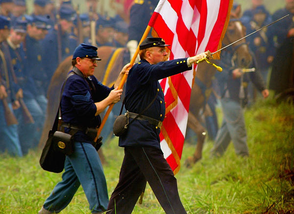 "Union officer leads his troops Saturday during battle with Rebel forces at ""Maryland, My Maryland"" Civil War re-enactment in Boonsboro."