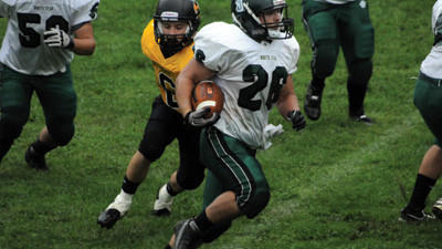 North Star running back Thomas Miller rushes around the outside and past Ferndales Taylor Kinsey in the first quarter Saturday.