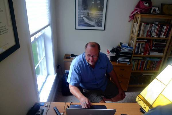 "Jeff Bardin, 54, logs into an Al Qaeda website from his home office in Barre, Mass. A former Air Force linguist who is fluent in Arabic, he is part of a loose network of ""hacktivists"" who spy on Al Qaeda and its allies."