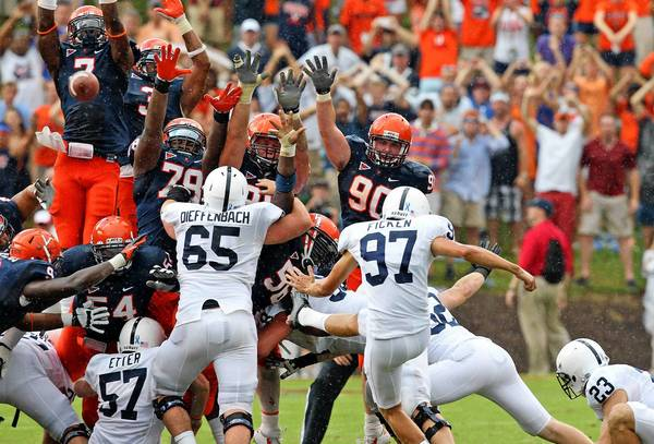 Virginia attempts to block the Penn State field goal on the final play of the game in the Cavaliers' 17-16 win Saturday, Sept. 8, 2012, at Scott Stadium.