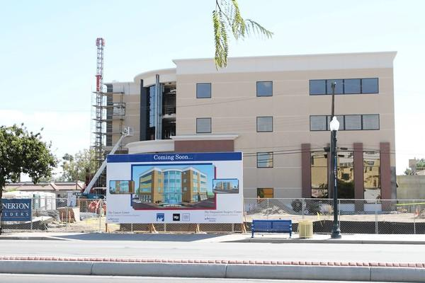 In one of many signs of Bakersfield's growth, San Joaquin Community Hospital downtown is building a four-story cancer treatment center.