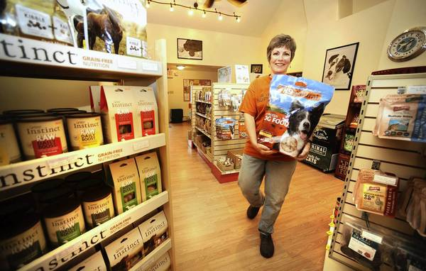 Julie E. Van Vliet , owner/manager of Doggy Dao & Cat's Meow, stocks her new shop in Hellertown.
