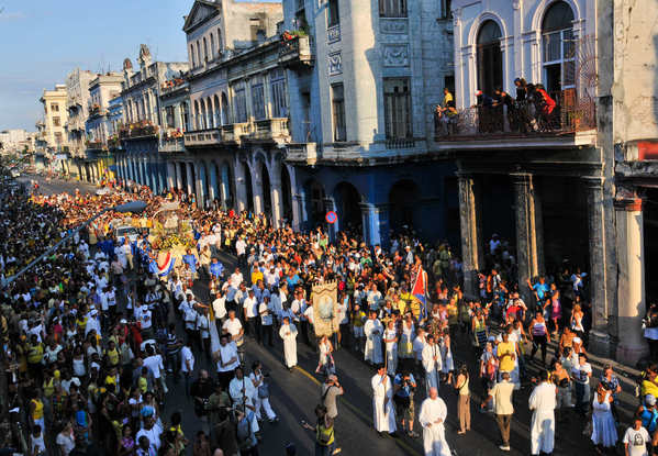 Cuban believers participate in the procession of Our Lady of Charity in Havana, on September 8, 2012, during the celebration of the 400 anniversary of her apparition.