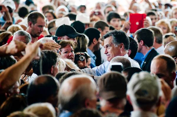 Republican presidential nominee Mitt Romney greets supporters at a campaign appearance at the Military Aviation Museum in Virginia Beach, Va.