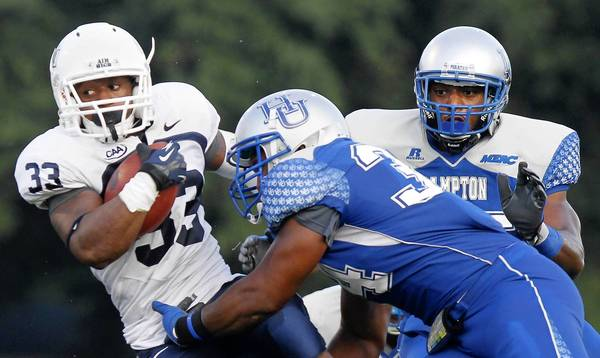 Old Dominion's Tyree Lee is brought down by Hampton's Delbert Tyler during the first half of Saturday's game.