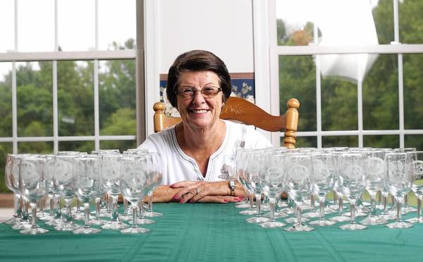 Peggy Conrad of New Windsor has been to the Maryland Wine Festival every year since the event began in 1984. She has collected 57 glasses from the event. Each glass is marked with the event's logo and the year of the festival.