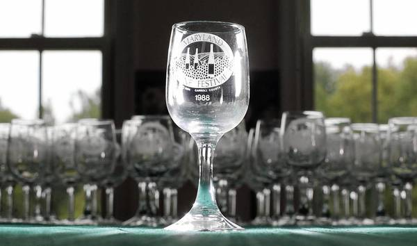 Peggy Conrad of New Windsor has been to the Maryland Wine Festival every year since the event began in 1984. She has collected wine glasses from the festival each year, including the one pictured from 1988.
