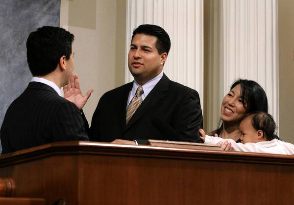 Assemblyman Felipe Fuentes, center, co-sponsored the bill to offer sanctuary for some illegal immigrants in the state.