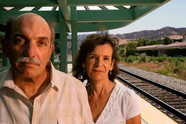 Jim Paulson and his wife, Nanci, both 62, are photographed at the Metrolink train station in Simi Valley. Jim Paulson received serious head injuries in the 2008 Metrolink crash in Chatsworth.