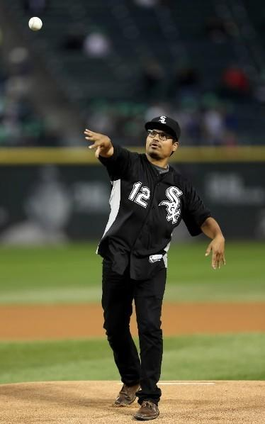 Actor Michael Pena throws out the ceremonial first pitch before the White Sox-Kansas City Royals game at U.S. Cellular Field September 7, 2012.