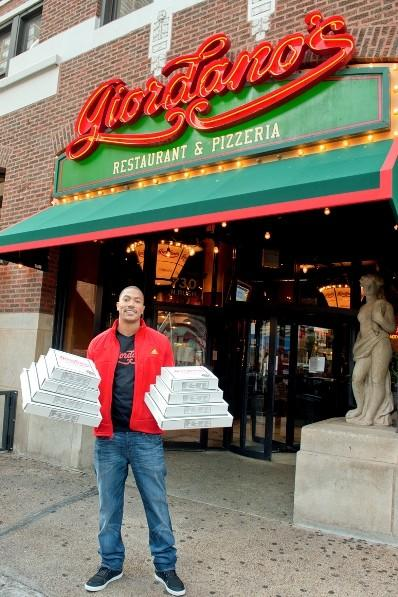 The Bulls' Derrick Rose in front of Giordano's Pizza on Rush Street September 6, 2012.