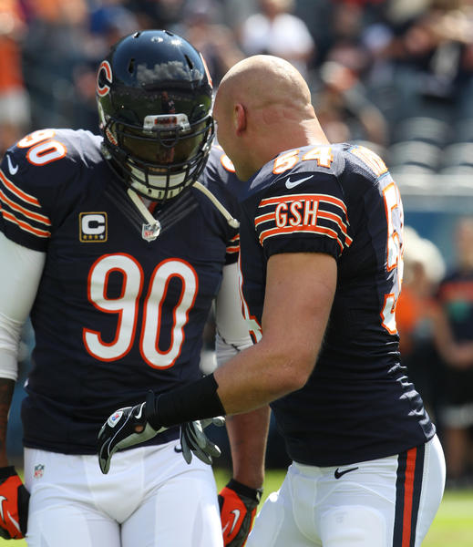 Chicago Bears defensive end Julius Peppers (90) and Chicago Bears linebacker Brian Urlacher (54) before the start of the game against the Indianapolis Colts at Soldier Field, in Chicago on Sunday, September 9, 2012.