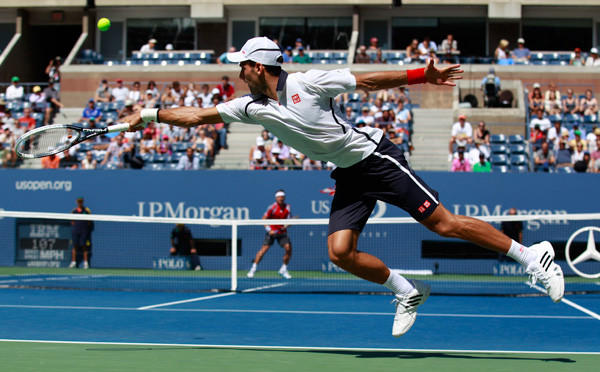 Djokovic of Serbia returns to Ferrer of Spain during their men's singles semifinals match at the U.S. Open tennis tournament.