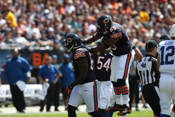 Chicago Bears linebacker Lance Briggs celebrates after the Bears make a stop in the second quarter during a game against the Indianapolis Colts at Soldier Field on Sunday, Sept. 9, 2012.