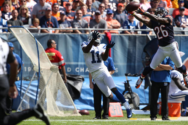 Chicago Bears cornerback Tim Jennings grabs an interception from Indianapolis Colts quarterback Andrew Luck during the second quarter of the season opener at Soldier Field on Sunday, Sept. 9, 2012.