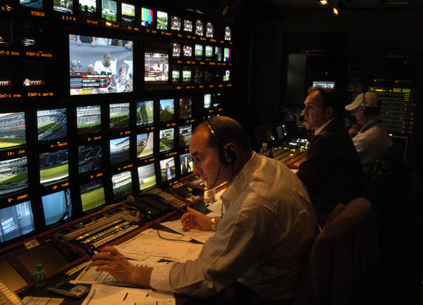 "Producer Jay Rothman, left, and director Chip Dean, center, produce ESPN's ""Monday Night Football."""