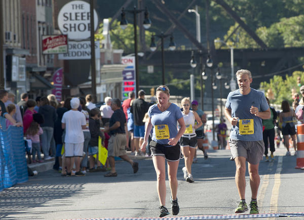 Runners head down the winding stretch on 3rd Street  in downtown Easton at the finish of the 2012  Lehigh Valley Health Network Marathon for VIA in  in Easton on Sunday. The event raises funds for Via of the Lehigh Valley¿s services for children and adults with disabilities like autism, cerebral palsy and Down syndrome. Since 1954, Via helps children and adults from birth through retirement focusing in Children¿s Services, Community Connections and Employment.