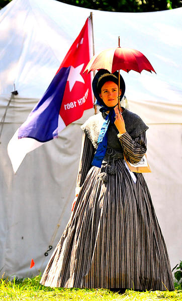 Cora Chandler strolls through sutlers village Sunday at 'Maryland, My Maryland' Civil War event in Boonsboro. She represents a middle-class civilian woman from Keedysville at the time of the 1862 battle in Sharpsburg. She is from Sussex, N.J.