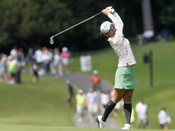 Ai Miyazato takes a shot from the fairway of the fourth hole during the last round of the LPGA Kingsmill Championship in Williamsburg on Sunday.