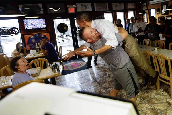 President Obama gets a lift from a supporter, Scott Van Duzer, owner of an Italian restaurant in Fort Pierce, Fla., where Obama was campaigning.