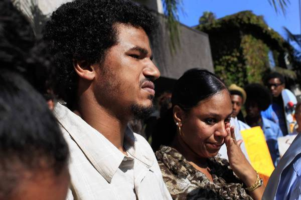 Ronald Weekley Jr. and his sister Lashan Smith listen as Pastor Horace Allen of First Baptist Church in Venice speaks to the media about Weekley's rough treatment by LAPD officers. Weekley, a skateboarder, was punched in the head several times during the incident.