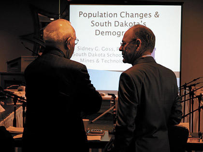 School of Mines and Technology professor Sidney Goss, right, makes chit-chat with South Dakota Retirement System board of trustees member Jim Hansen of Pierre prior to a presentation last week by Goss.