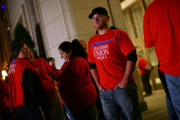 Special Ed. teacher Ryan Mekeel and fellow CTU members gather outside the Merchandise Mart.