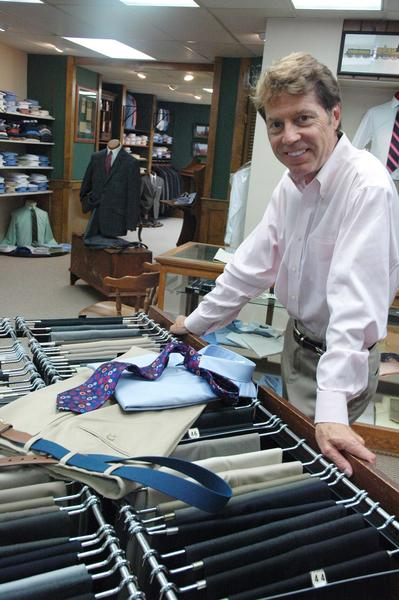 Jeff Pagel, owner of The Clothes Post in Petoskey, shows a darker tan slack more typically worn after Labor Day.
