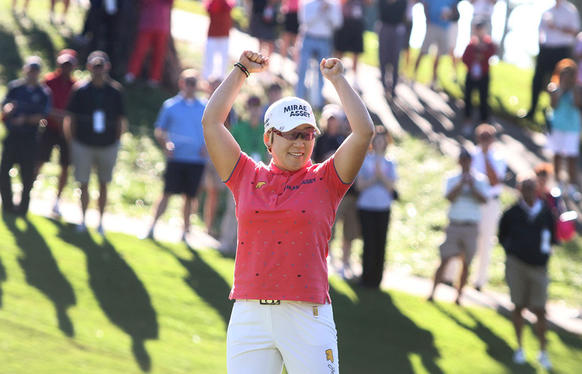 After nine play-off, Jiyai Shin celebrates her victory over Paula Creamer at the 16th hole during 2012 Kingsmill Championship on Monday morning.