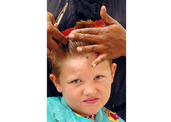 Wesley Brooks, 7, of Huntsville, Ala., has his hair cut by Melinda Gilbert at the J.C. Penney styling salon in Huntsville.