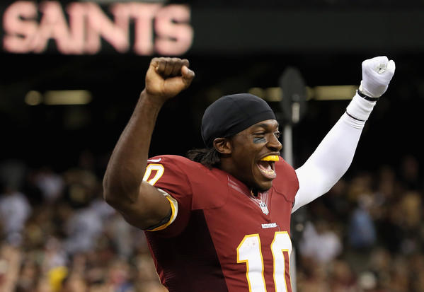 Robert Griffin III celebrates the Redskins' victory Sunday.