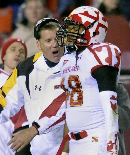 Randy Edsall yells at Dan Fox (48) after his penalty cost 15 yards and kept a Notre Dame scoring drive alive at FedEx Field in Landover, Maryland, on Saturday, November 12, 2011. (