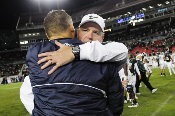 UConn head coach Randy Edsall gives a hug to USF head coach Skip Holtz after the Huskies 19-16 win over University of South Florida at the Raymond James Stadium in Tampa Saturday for the last game of the regular season. With the win, they have earned a BCS berth.