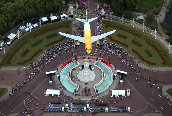 A British Airways Airbus aircraft flies over the Queen Victoria Memorial at Buckingham Palace during the London 2012 Victory Parade for Team GB and Paralympic GB athletes on September 10, 2012 in London.