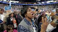 "A delegate from North Carolina stands and shouts ""Four more years!"" during President Barack Obama's acceptance speechat the Democratic National Convention. As hosts to the gathering in Charlotte, the North Carolina delegation had the best seats in Time Warner Cable Arena. (Photo by Steve Appleford)"