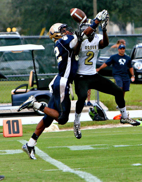 Orlando University receiver Brad Harris battles Ocoee cornerback Robert Owens for a pass intended for Harris during University's 10-6 win (Sept. 8, 2012)