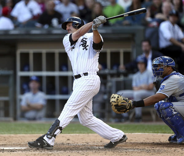 Chicago White Sox hitter Paul Konerko hits a solo homer in the 6th inning against the Kansas City Royals at U.S. Cellular Field in Chicago on Saturday, September 8, 2012. (Chris Sweda/ Chicago Tribune)