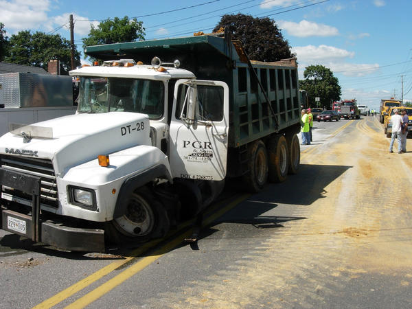 A wrecked dump truck sits near the intersection of Wagaman Road and Sharpsburg Pike Monday afternoon. Two dump trucks collided at the intersection due to a cement truck that was stopped along the highway, Maryland State Police said.