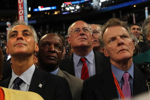 Chicago Mayor Rahm Emanuel, seen here during the convention last week with top Illinois Democrats, has stopped national fundraising during the teacher strike.