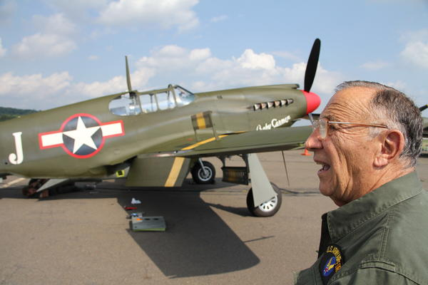 Frank Mirto, of Cheshire, came to the Waterbury-Oxford Airport Friday afternoon to observe the World War Two fighters and bombers on display at the Collings Foundation's Wings of Freedom Tour. Mirto served in the United States Air Force from 1947 to 1953, where he worked as a mechanic on a reconnaissance version of the P-51 Mustang.