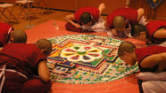 Tibet is coming to Trinity College in the form of a large eight-by-eight-foot work of art made of sand. And it's not arriving completed. Six Buddhist nuns from the Keydong Thuk-che Choeling Nunnery in Nepal arrived for the third time at Trinity College in August to take part in a month-long process of making a mandala. For those of you who don't know, a mandala is a religious painting made from white nuggets found in Tibet that have been collected and later crushed and dyed. On September 15, in the Austin Arts Center's Garmany Hall at 1 p.m., the process of making the mandala will be initiated. Participants will also get the chance to see the mandala disassembled and later scattered into the Connecticut River at the Charter Oak Landing in Hartford on October 14.